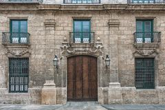 Picture of old vintage building facade with wooden door and stone walls.  stock photos