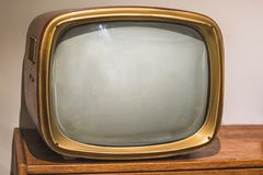 Picture of old vintage tv on the wooden shelf. Picture of old vintage tv on the wooden shelf Royalty Free Stock Photos