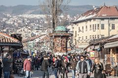 Pigeons flying over the Bascarsija square Sebilj fountain. Bascarsija is the symbol of Sarajevo, with its oriental architecture Royalty Free Stock Images