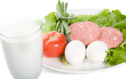 Picture of onion, eggs, glass of milk, ham, tomato Royalty Free Stock Photos