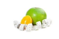 Picture of orange and grapefruit with measure tape Royalty Free Stock Image
