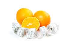 Picture of oranges and measure tape Royalty Free Stock Photo
