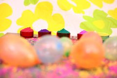 Picture of organic color and colorful water balloons for holi fun. Isolated on the colorful background royalty free stock photo