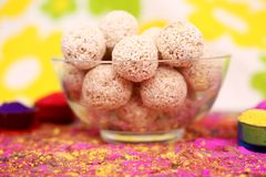 Picture of organic holi color with cholai ke ladoo in the bowl. Isolated on the colorful background stock images