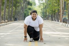 Overweight woman ready to run at outdoor Royalty Free Stock Images