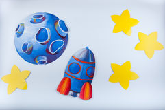 Picture painted by gouache. Blue planet, rocket and yellow stars on white background Stock Images