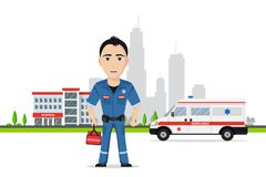 Picture of a paramedic. Picture of paramedic in front of ambulance car and hospital building Royalty Free Stock Image