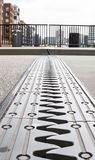 Metal stripe on a bridge. Picture of the part of a bridge which adjustes to the temperature stock images