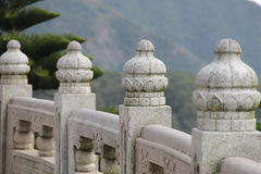 Picture of the part of the Chinese traditional carving marble fence of the Temple big Buddha. Hong Kong Stock Images