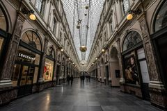 Queen`s passage Passade le la Reine in the Royal Galleries Galeries Royales with a Longchamp shop in front. Picture of Passage de la Reine in the Galeries Stock Photography