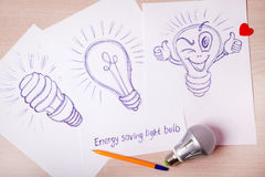 Picture pen Energy saving light bulb on the white paper Royalty Free Stock Photo