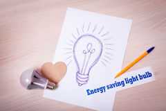 Picture pen Energy saving light bulb on the white paper Stock Photos
