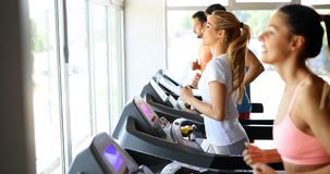 Picture of people running on treadmill in gym royalty free stock photos