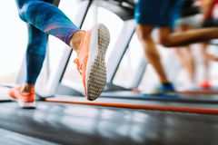 Picture of people running on treadmill in gym stock images