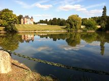 Picture Perfect Chateau with a lake Stock Images