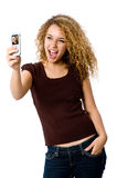 Picture Phone. A young woman taking her self-portrait with a camera phone royalty free stock photo