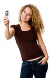 Picture Phone. A young woman taking her self-portrait with a camera phone stock photo