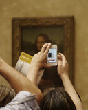 Picture in Picture... Mona Iisa Through an iPhone Royalty Free Stock Images