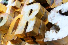 Pile of rusty letters. A picture of a pile of rusty letters for sale at a flea market Stock Photo