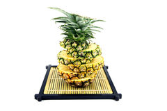 Picture pineapple slices stacked on a bamboo dish. Royalty Free Stock Photography