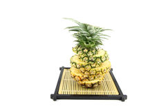 Picture pineapple slices stacked on a bamboo dish. Stock Photos