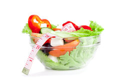 Picture of a plate with greek salad and tape- measure Stock Photo