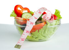 Picture of a plate with greek salad and tape- measure Royalty Free Stock Photos