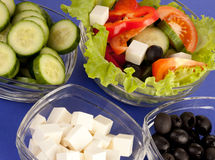 Picture of plates with greek salad and ingridients Royalty Free Stock Photo
