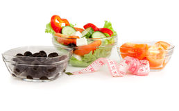 Picture of a plates with greek salad, tomatoes  and black olives Stock Photo