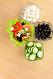 Picture of plates with vegetables and greek salad Stock Images