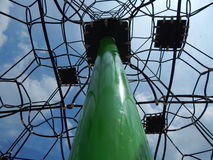 Picture on a playground. Seats and climbing-ropes in the blue sky Stock Images