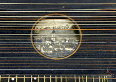 Picture postcard under the sound hole of a zither Royalty Free Stock Photo