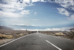 Picture presentic rural landscape with an empty road in the midd Royalty Free Stock Photos