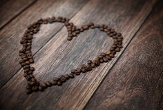 Picture presenting fragrant heart made of coffee beans Stock Photography