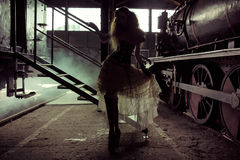Picture presenting silhouette of the woman in the old railway st Royalty Free Stock Image