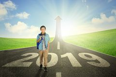 Preteen boy student walks above number 2019 royalty free stock photos