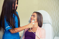 Picture of pretty beautician doing microdermabrasion procedure f Stock Images