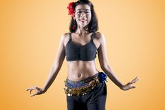 Pretty belly dancer doing dance exercises on studio royalty free stock photos