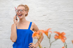 Picture of pretty girl in big glasses speaking Royalty Free Stock Photography