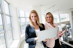Picture of professional salesperson working in car dealership. Picture of professional female salesperson working in car dealership royalty free stock photography