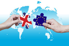 Picture puzzles of the UN and the EU have been pulled apart Stock Photography