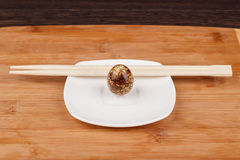 The picture quail eggs. On a wooden board Royalty Free Stock Photography