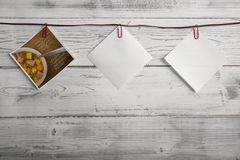 Picture with recipe and empty notepads hanging on ribbon Royalty Free Stock Images