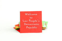 Picture of a red note paper with text welcome to laos stock photo