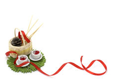 Picture with red ribbon, two miniature cups and decorations Stock Photo