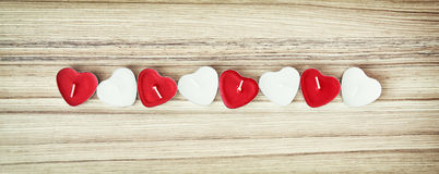 Picture of red and white heart candles on the wooden background, Royalty Free Stock Photo