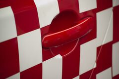 Picture of red and white squares livery on racing car. royalty free stock photo