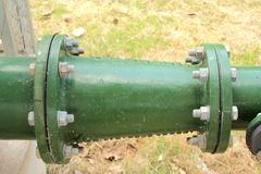 Green reducing pipe between flange royalty free stock photos