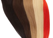 Picture of remy woman`s hair extensions in different colors Royalty Free Stock Images