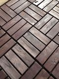 Repeating square wood panels. A picture of repeating square wood panels on a back patio Royalty Free Stock Photography